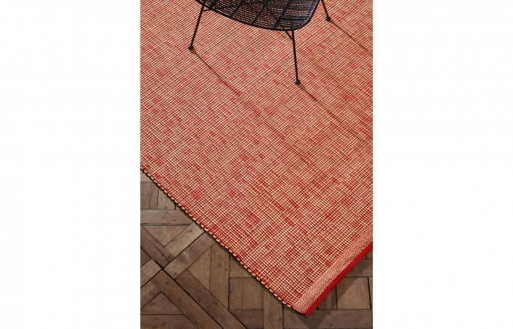 Tapis en raphia de la collection « Binaire » (La Manufacture Cogolin).